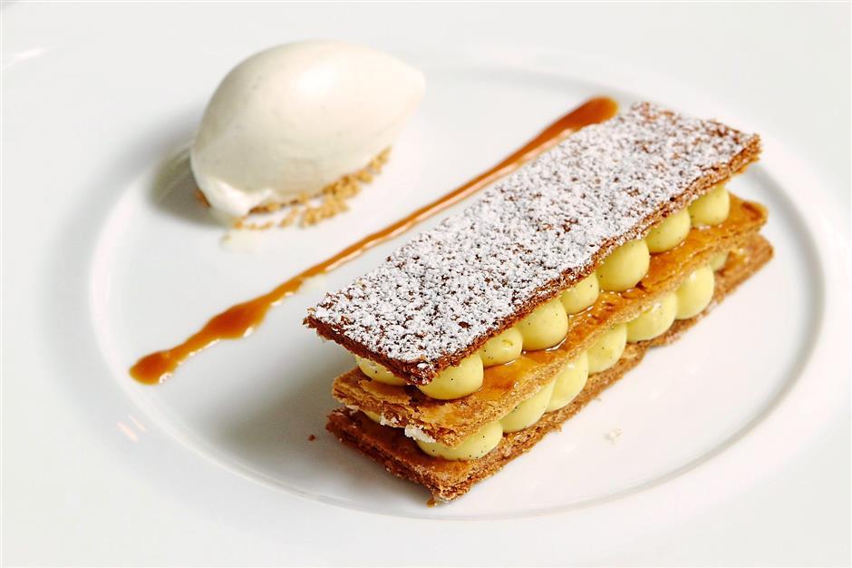 Traditional vanilla millefeuille, vanilla ice cream and caramel sauce.