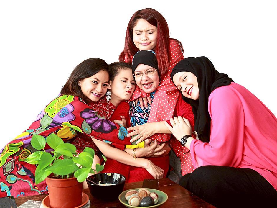 Sharifah Amani, Sharifah Aleysha, Fatimah Abu Bakar, Sharifah Aryana and Sharifah Aleya (left to right) at the family home in Petaling Jaya.