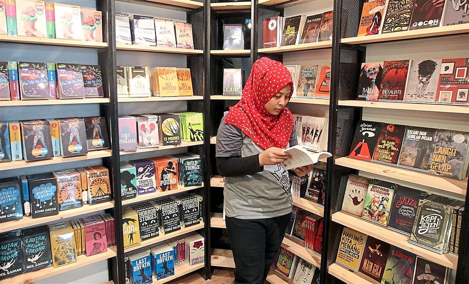 A place for Amir's books: All of Fixi's varied output is available at its first brick and mortar store. Photos: AZHAR MAHFOF/The Star