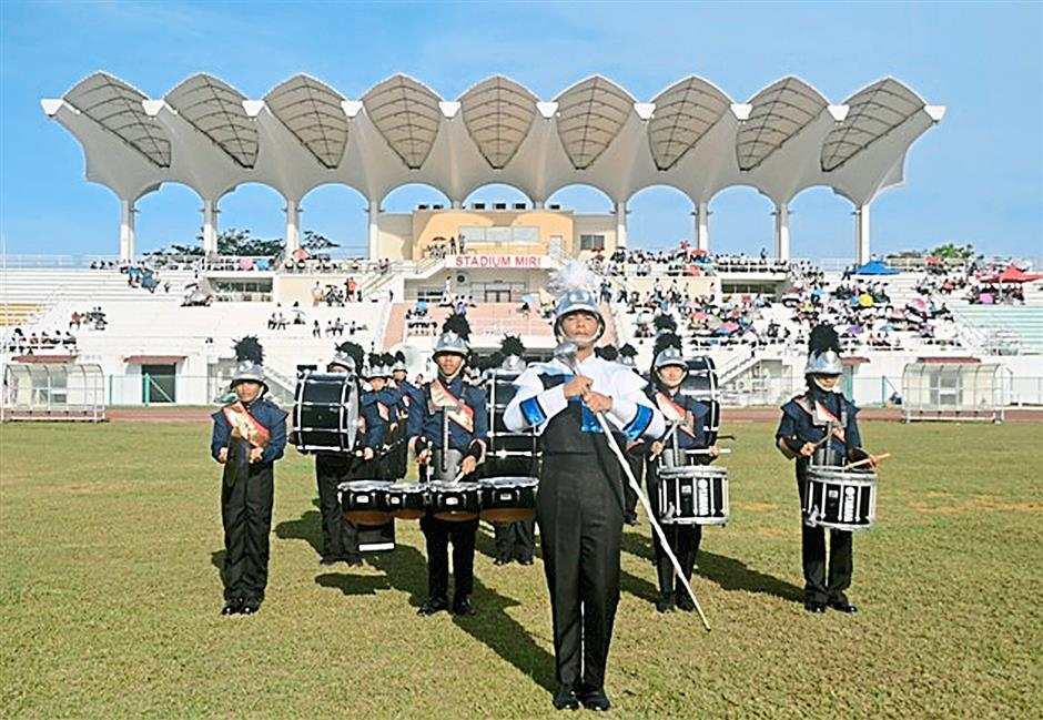 Active ensemble: The group performing at SMK St Columbaâ¿TMs 59th Annual Sports Day at Miri Stadium.