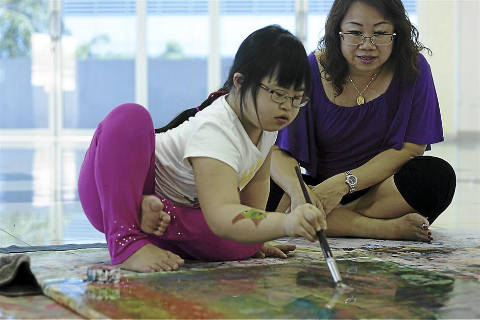 Wendy Goh describes her 10-year-old daughter Cassandra Goon's paintings as