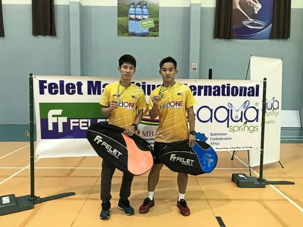 Class above: Boon Xin Yuan (left) and Yap Qar Siong made their club Serdang BC proud by winning the menu2019s doubles title at the Mauritius International badminton tournament on Sunday.