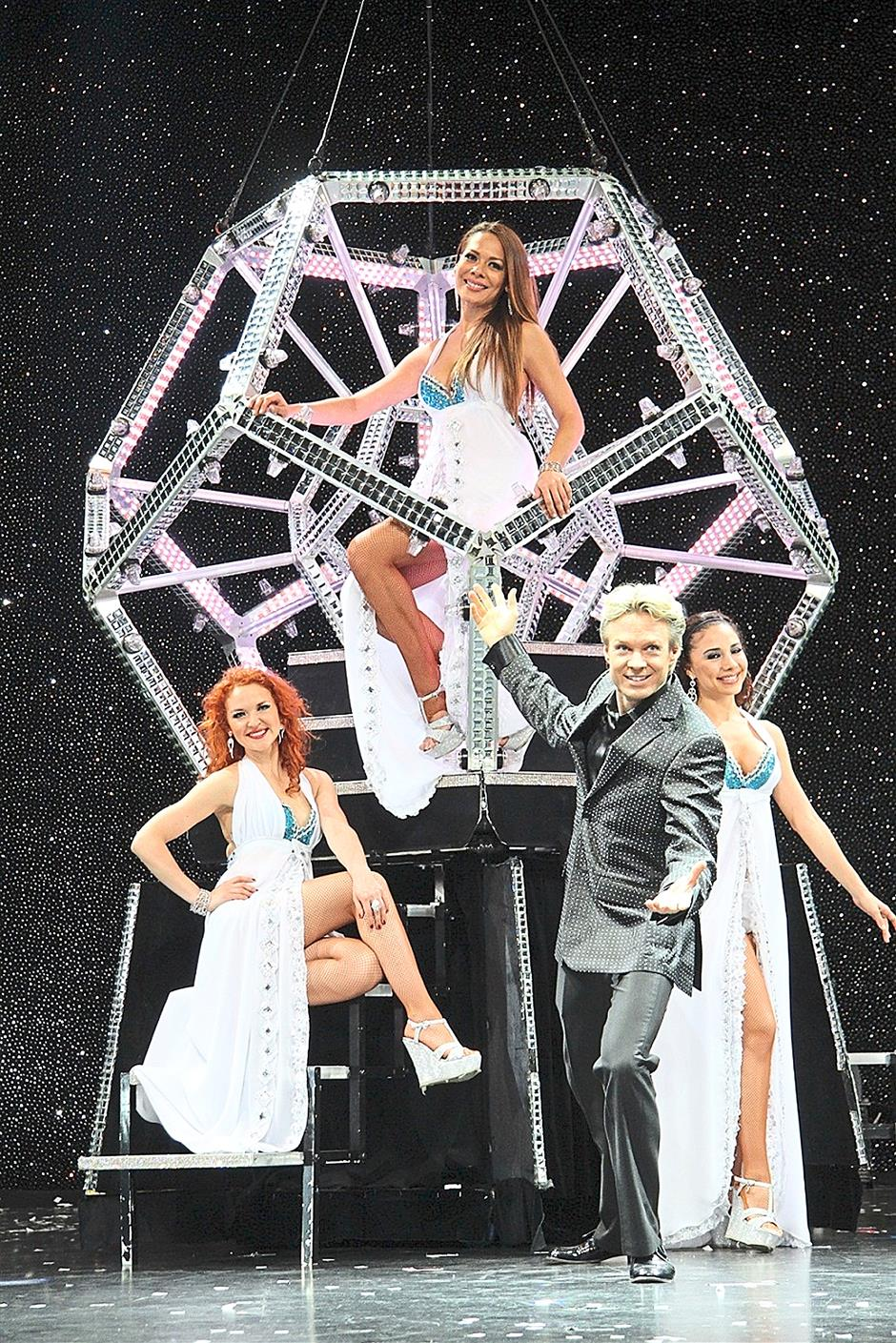 Be dazzled by Marvey and his bevy of beautiful assistants at the show, in which one of the greatest illusions is the Diamond Illusion that utilises the giant see-through polygon seen here.