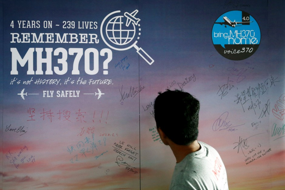 A man looks at a message board in remembrance of victims on board the missing Malaysia Airlines Flight MH370, during its fourth annual remembrance event in Kuala Lumpur on March 3, 2018. u2013 Reuters/Lai Seng Sin