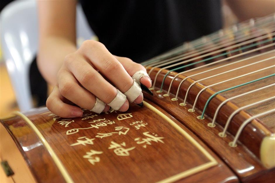 Shireen Chin Mei Yee playing the Chinese Zither (Guzheng) at one of the rehearsal sessions before the performance