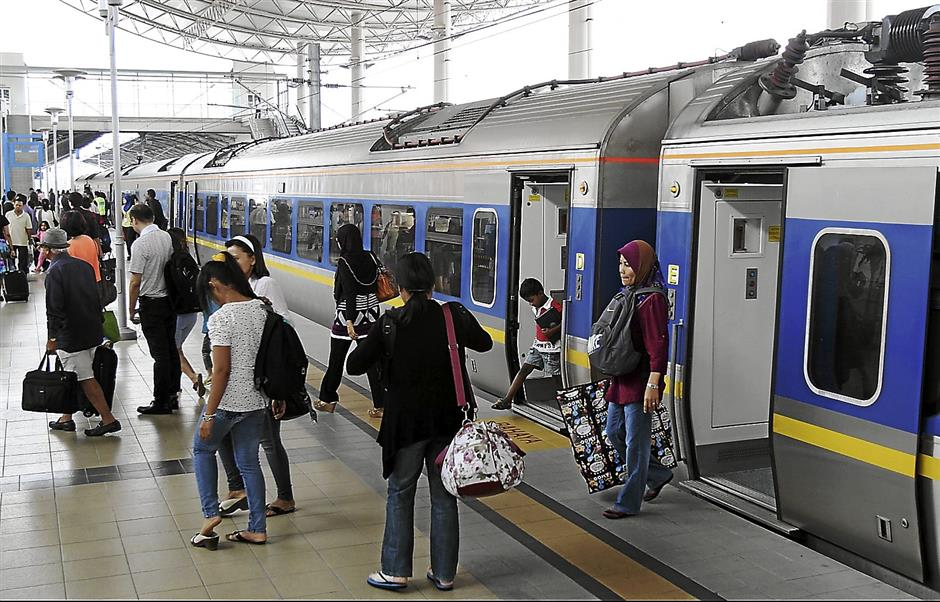 Passengers from Kuala Lumpur arriving at the Ipoh Railway station.