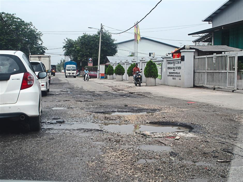 Price of prosperity: The roads are riddled with potholes.