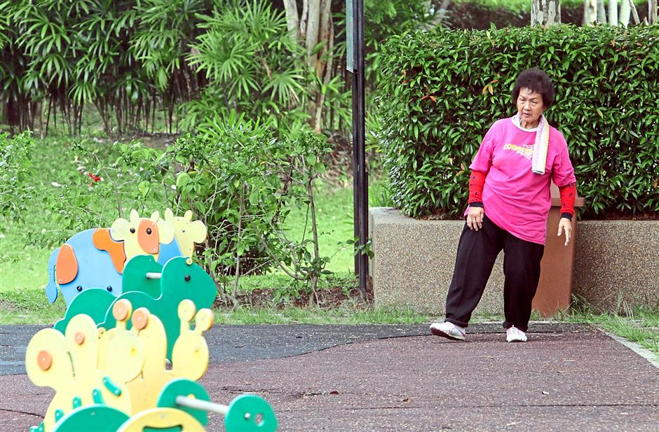 Occupied: A senior citizen exercising in a park