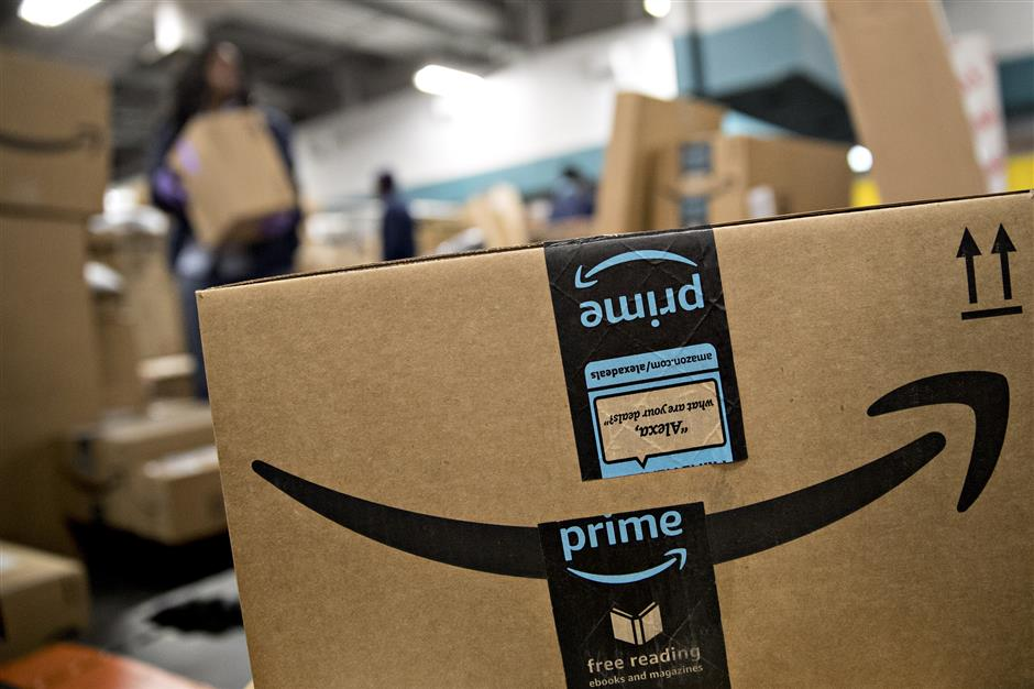 An Amazon.com Inc. package sits before delivery at the United States Postal Service (USPS) Joseph Curseen Jr. and Thomas Morris Jr. processing and distribution center in Washington, D.C., U.S., on Tuesday, Dec. 12, 2017. The USPS said it expects to deliver over 15 billion total pieces of mail this holiday season with expanded Sunday delivery operations in certain areas, delivering over six million packages each Sunday in December. Photographer: Andrew Harrer/Bloomberg