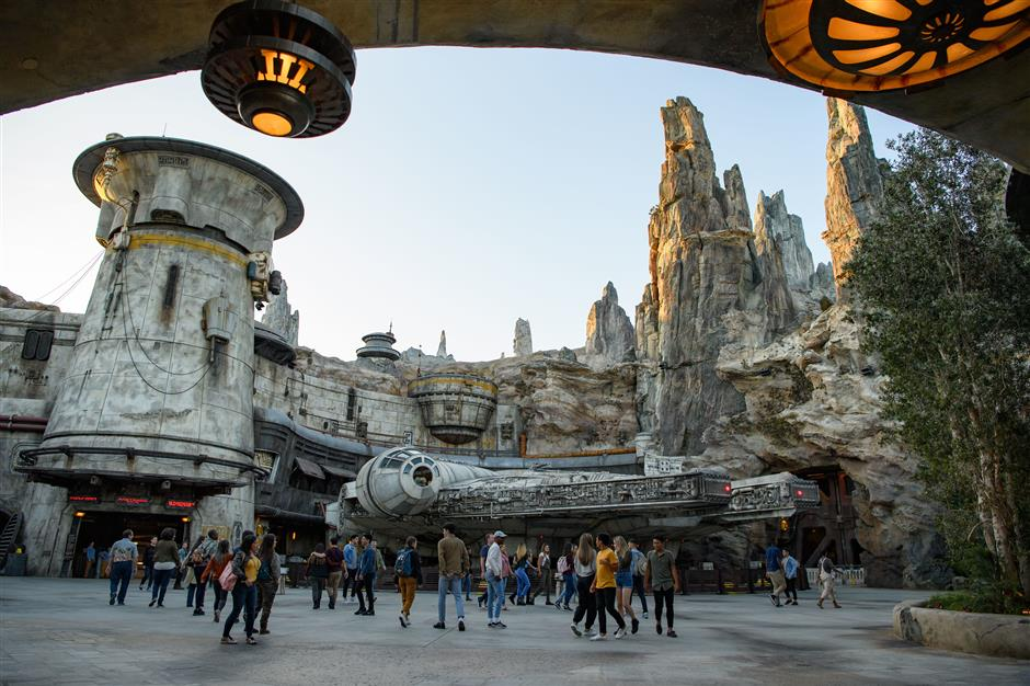 Star Wars: Galaxyu2019s Edge at Disneyland Park in Anaheim, California, and at Disney\'s Hollywood Studios in Lake Buena Vista, Florida, is Disney\'s largest single-themed land expansion ever at 14-acres each, transporting guests to Black Spire Outpost, a village on the planet of Batuu. Guests will discover two signature attractions. Millennium Falcon: Smugglers Run (pictured), available opening day, and Star Wars: Rise of the Resistance, opening later this year. (Todd Wawrychuk/Disney Parks)