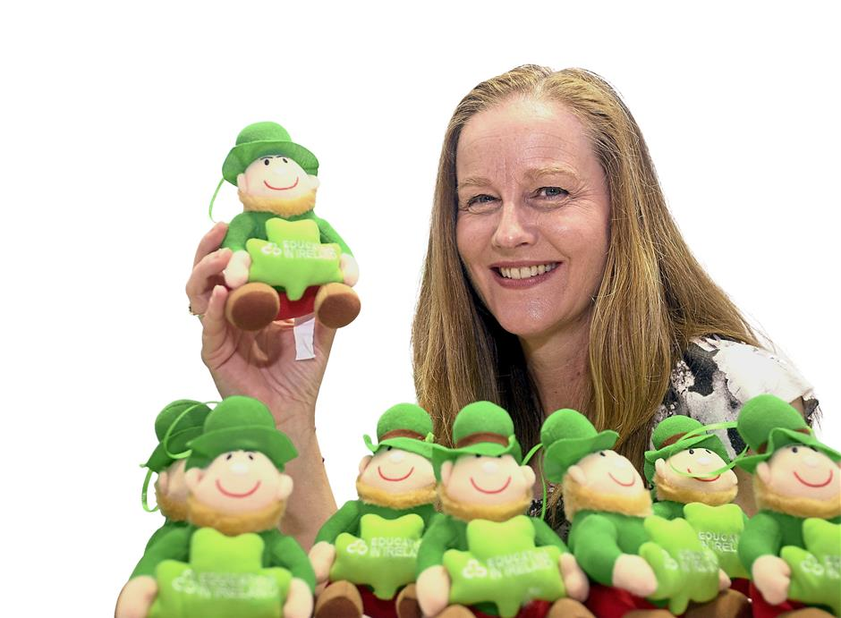 Education in Ireland regional manager (Asia) Elizabeth McHenry holds little green leprechaun dolls that were snapped up at the booth by visitors who were at the fair to learn more about studying in Ireland.