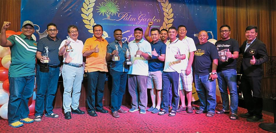 Chin (fourth from left) and Maniam (fifth from left) with the other winners and officials at the prize presentation.