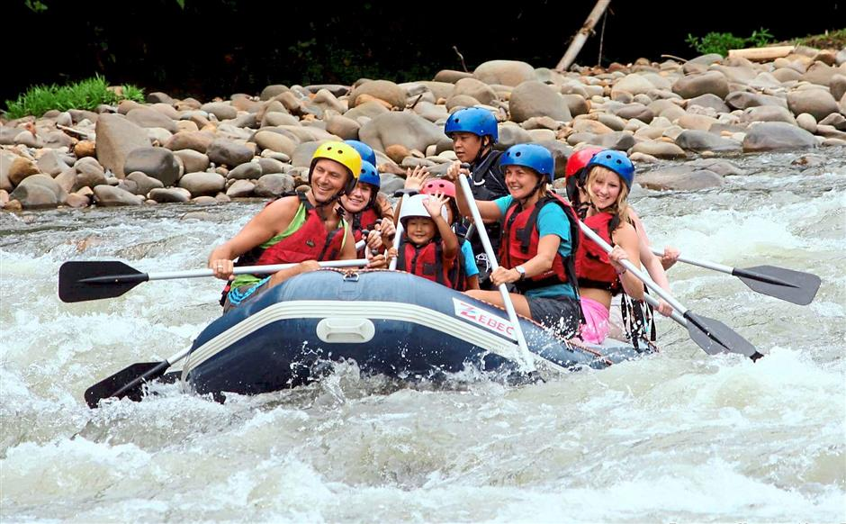 Nature at its best: Adventure lovers usually head further inland to indulge in white-water rafting along the Kiulu river which flows at a calmer pace (below) as it meanders through Tamparuli.