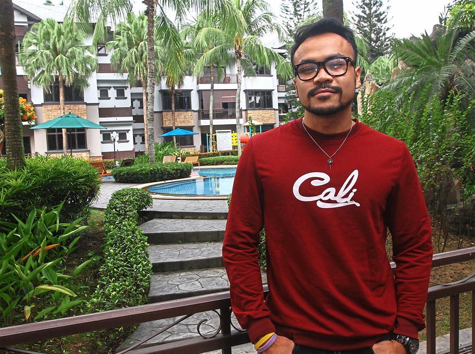Mohamed Farhan Johari, 29, quit his job as a flight attendant to become a full-time gamer/streamer. — MOHD SAHAR MISNI/The Star