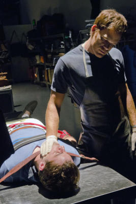 No hard feelings: Dexter Morgan (Michael C. Hall) gets ready to do what he does best ... smother the life out of someone else.
