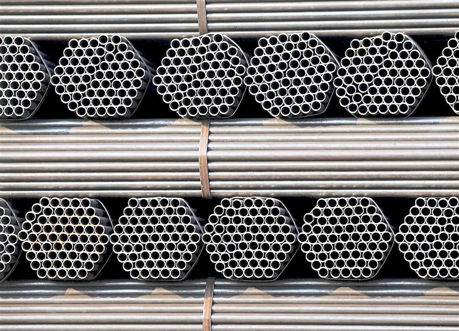 Steel pipe products are piled at the yard of a steel pipe plant in Tangshan in Chinas Hebei Province in this November 3, 2015 file photo. Chinese steel prices hit record lows on November 17, 2015 amid prolonged worries over shrinking demand in the worlds top consumer that market sources say has forced one of the countrys largest private producers to cease output.  REUTERS/Kim Kyung-Hoon/Files