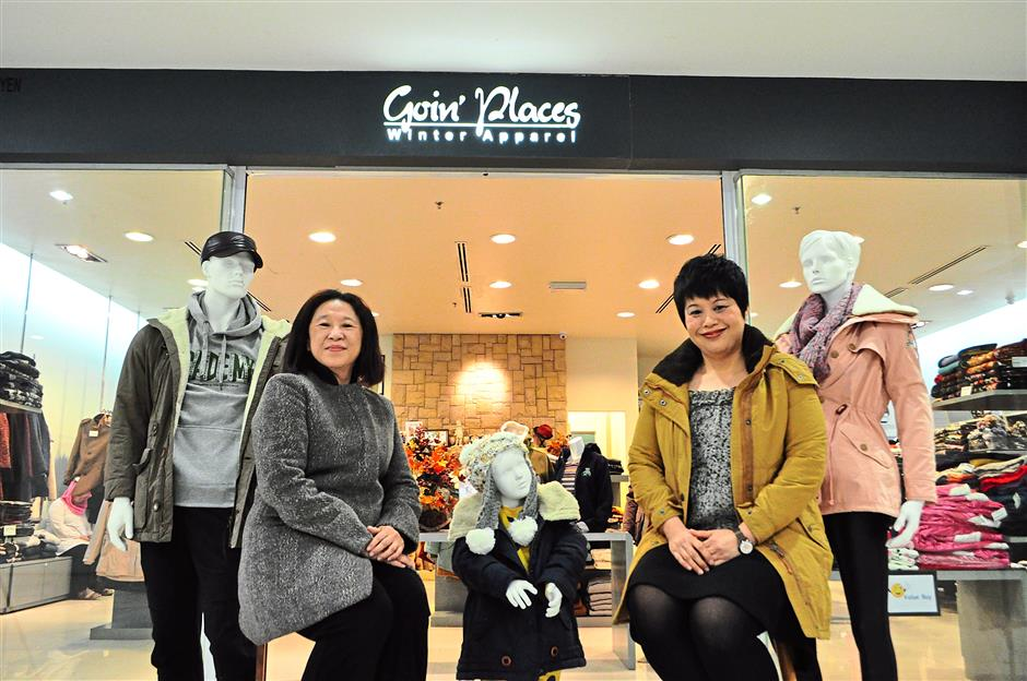 Khoo (left) and Goin Places brand manager Lee Ai Fong. The store offers a variety of winter wear for a host of clientele ranging from grandparents to babies.