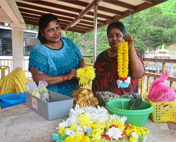 Vijaletchmi (left) and her mother Kuppu have been selling flower garlands at Hwa Kuo Shan Temple for the last three years.