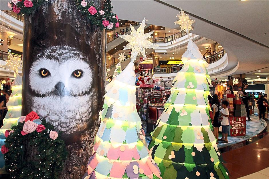 Snow-capped Christmas trees made of paper surround 1 Utamas centre court.  1 Utamas Christmas Launch 2014  on December 3,  2014.ROHAIZAT MD DARUS/STAR.
