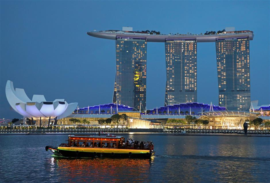 A tourist bum boat passes by the Marina Bay Sands hotel in Singapore July 3, 2019. Picture taken on July 3, 2019. REUTERS/Lim Huey Teng