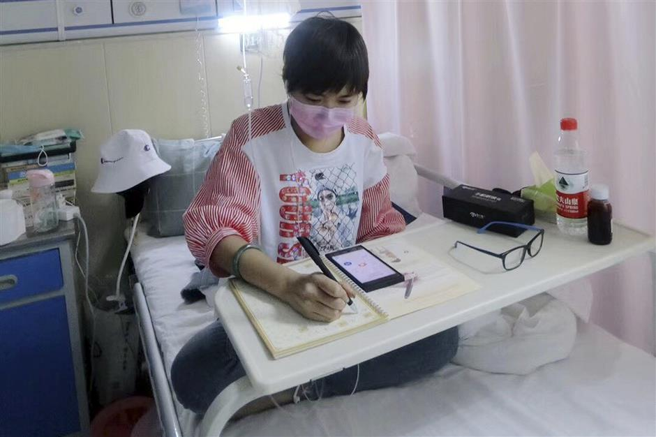 This May 2018, photo released by Su Lingmin shows her with a mask at her hospital bed in Harbin in northeastern China's Heilongjiang province. Diagnosed with leukemia four months ago, the 27-year-old native of the north China city of Harbin is helping give a human face to the struggle for more affordable cancer drugs in China. (Sun Lingmin via AP)