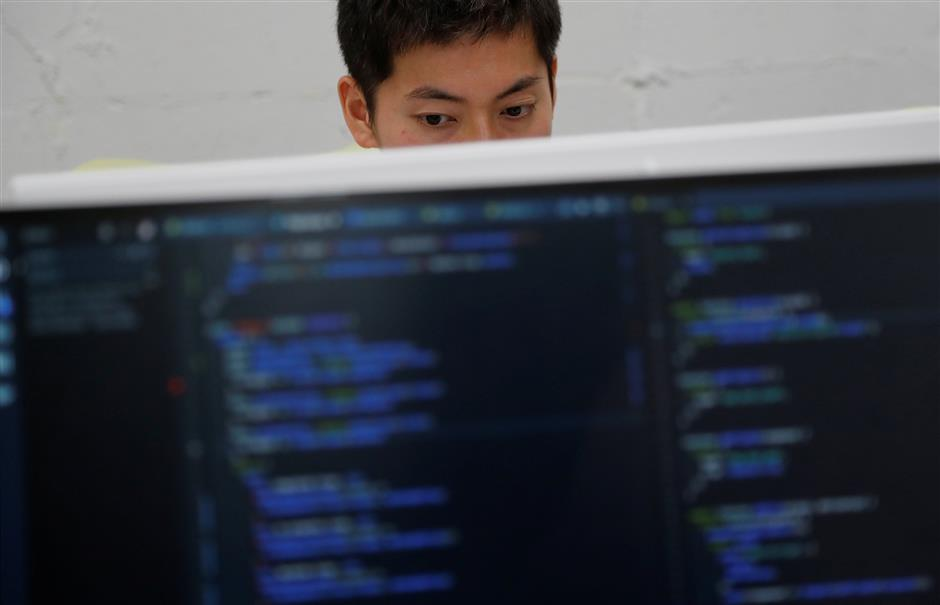 A student attends Code Chrysalis, a software-coding boot camp, at a basement room in Tokyo, Japan, May 23 2018. Picture taken May 23 2018. REUTERS/Toru Hanai
