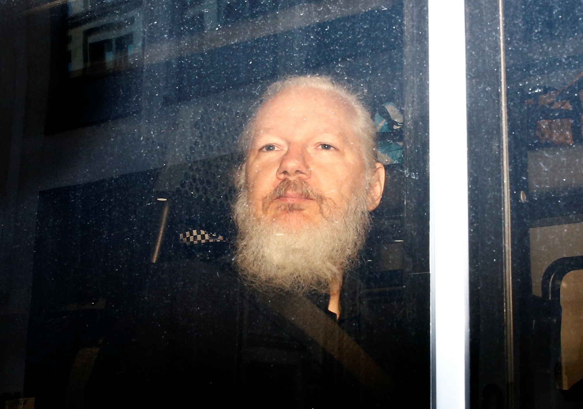 FILE PHOTO: WikiLeaks founder Julian Assange is seen in a police van, after he was arrested by British police, in London, Britain April 11, 2019. REUTERS/Henry Nicholls