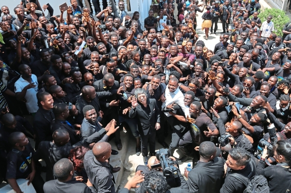 Lim (middle) received a rapturous welcome at Limkokwing University Sierra Leone on his arrival. — File pic