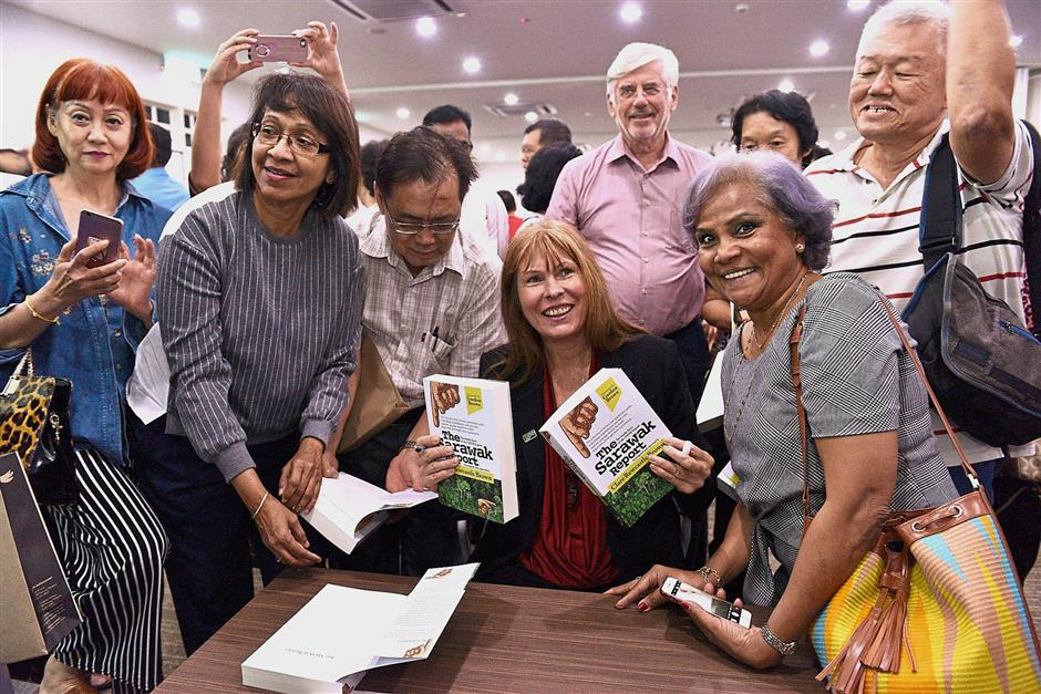 Rewcastle Brown (seated) taking photographs with those who bought her book u2018The Sarawak Report: The Inside Story of the 1MDB Exposeu2019. u2014 Photos: GARY CHEN/The Star