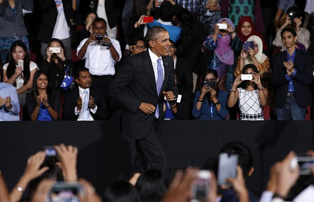 US President Barack Obama answering questions of Asian youth leaders at the Young South East Asian Leaders Initiative Town Hall, at the University of Malaysia, in Kuala Lumpur, Malaysia, 27 April 2014. - AFP