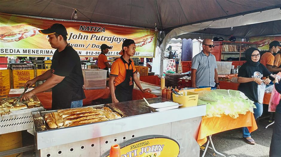 The Roti John business getting ready to serve customers.