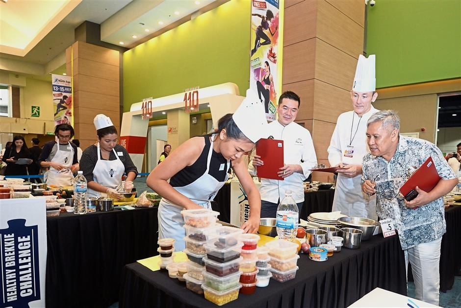 (From right) Chef Wan, Onno and Chin judging participants of the Live Great Healthy Brekkie Challenge.