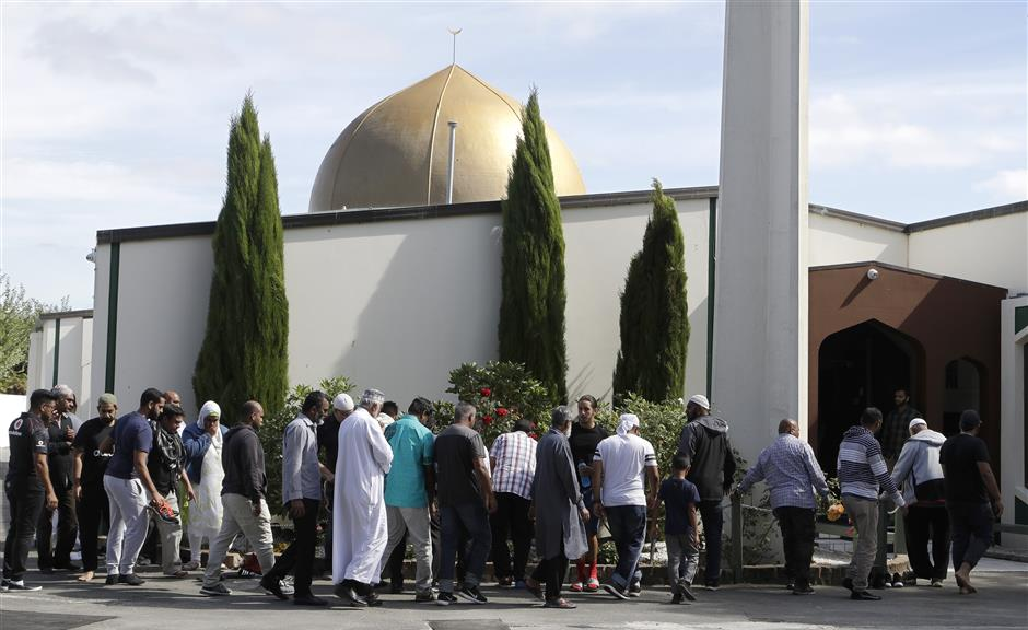 Worshippers prepare to enter the Al Noor mosque following last week\'s mass shooting in Christchurch, New Zealand, Saturday, March 23, 2019. (AP Photo/Mark Baker)