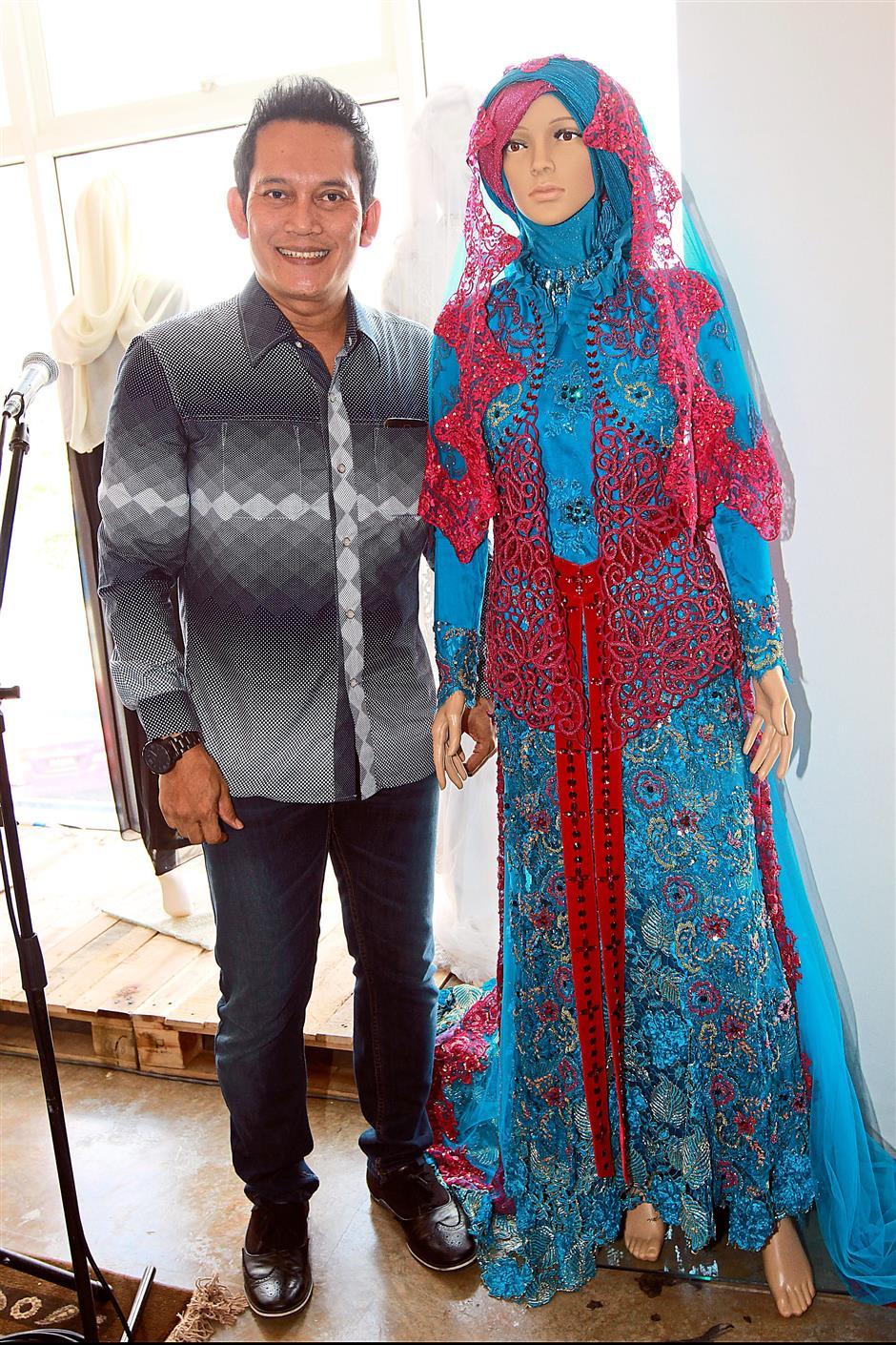 Creative flair: Indonesian designer Toera Imara with one of his designs.