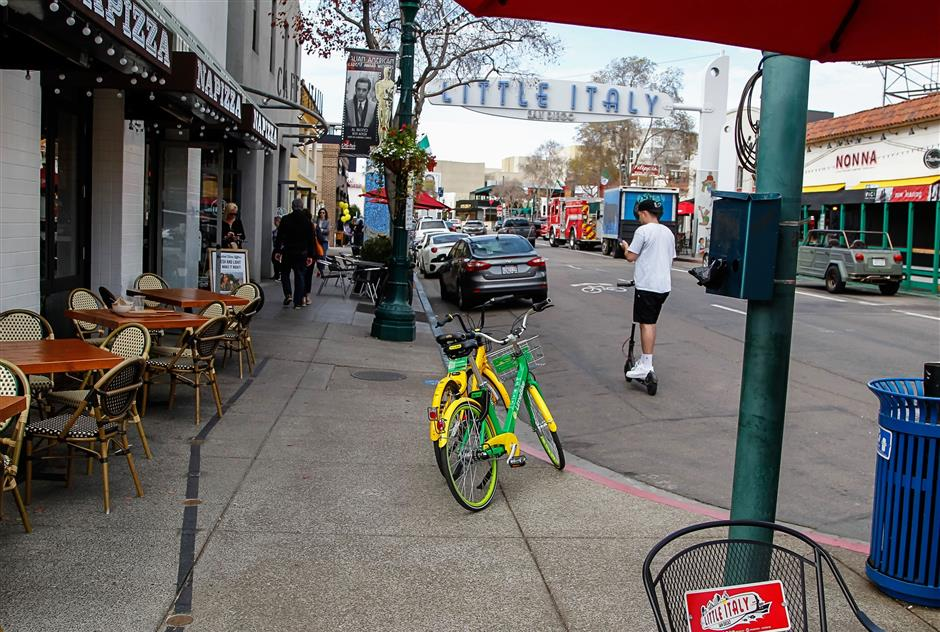 Dockless rental bikes at the corner of Grape and India Streets in San Diego\'s Little Italy on March 8, 2018. Merchants are not happy with the bikes cluttering sidewalks. (Eduardo Contreras/San Diego Union-Tribune/TNS)