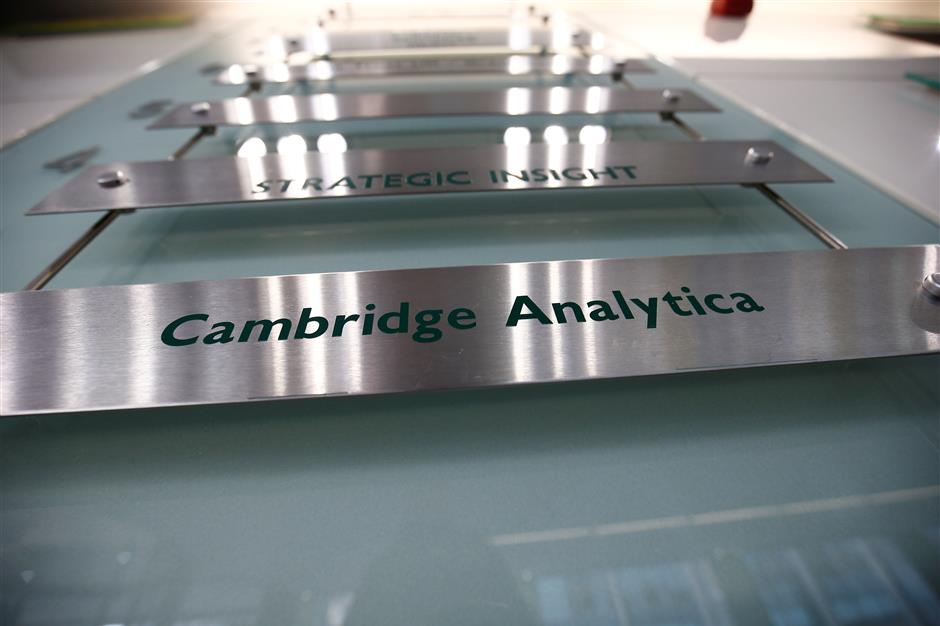 The nameplate of political consultancy, Cambridge Analytica, is seen in central London, Britain March 21, 2018.   REUTERS/Henry Nicholls