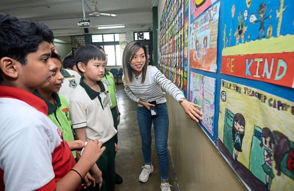 A labour of love: Chia (right) with students of Stella Maris Primary School, Ampang, who took her on a tour of the school's Kindness Initiatives.