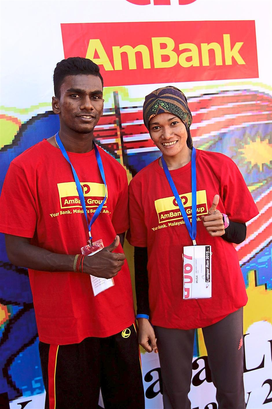 Champions: Thevan and Noor Amelia giving the thumbs up to the race.
