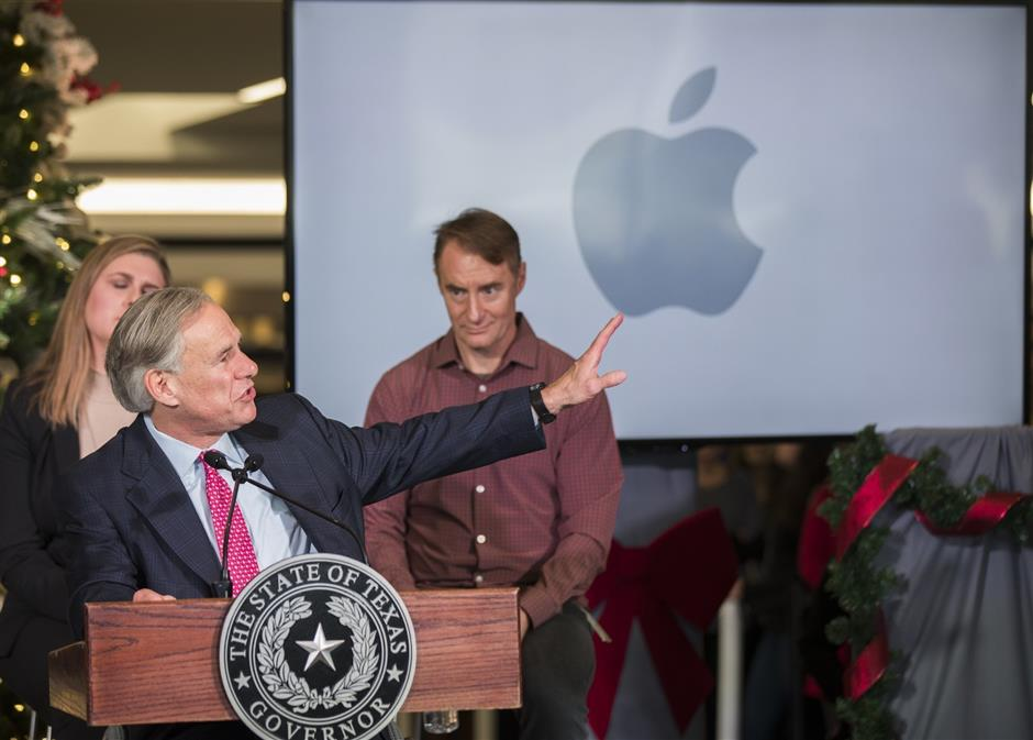 Texas Gov. Greg Abbott speaks about Apple\'s new campus announcement in Austin, Texas, Thursday, Dec, 13, 2018. Apple plans to build a $1 billion campus in Austin, that will create at least 5,000 jobs ranging from engineers to call-center agents while adding more luster to a Southwestern city that has already become a bustling tech hub. The decision, announced Thursday, comes 11 months after Apple CEO Tim Cook disclosed plans to open a major office outside California on the heels of a massive tax break passed by Congress last year. (Ricardo Brazziell/Austin American-Statesman via AP)