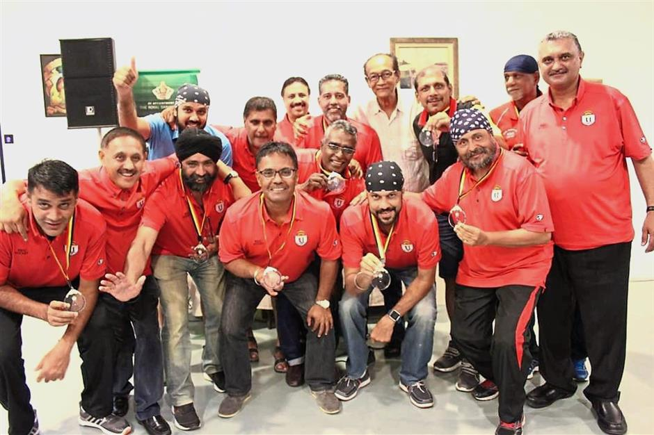 Harcharan (front row, third from right) and Daljeet (right) with the rest of the RSUC team proudly showing their runner-up medals.