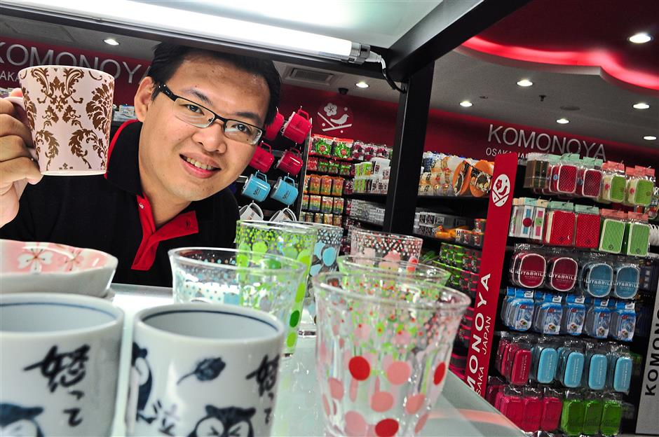 Leong of Konomoya shows off under-shelf lighting as a way to bring attention to the pretty designs of their crockery.