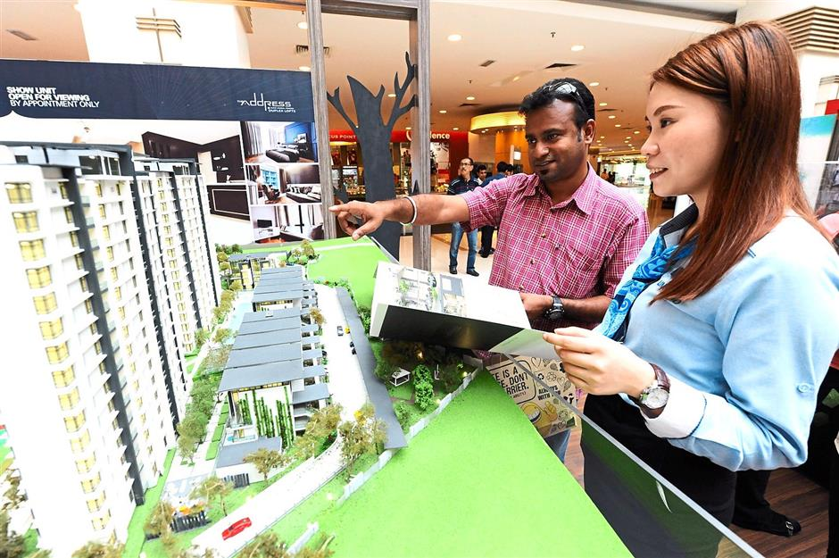 Drawn to project: Kumar discussing IJM Land Bhd's The Address with IJM sales and marketing officer Wah Yen Wai at the Star Property Fair 2015 in Seberang Jaya.