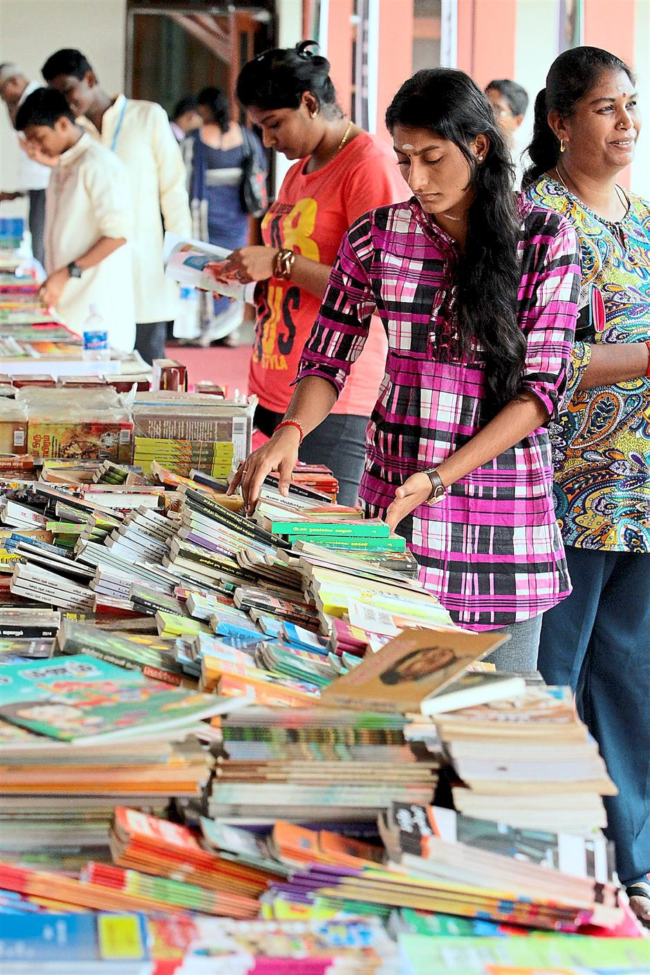 Wide selection: Poetry lovers browsing at the book exhibition at the inaugural festival.