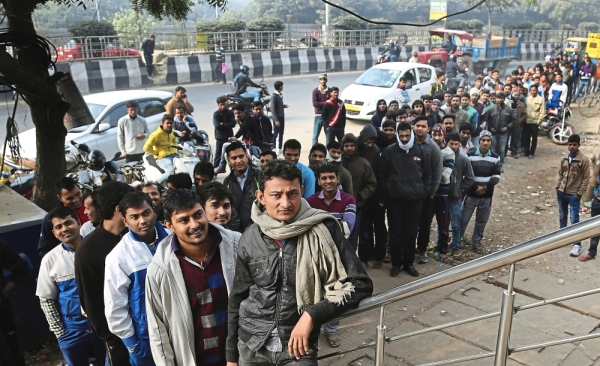 Indians wait outside a bank to withdraw money on the outskirts of New Delhi, India, Thursday, Dec. 8, 2016. Removal of 86.5% of Indian currency was intended to show the capability of a BJP-led administration. It backfired.