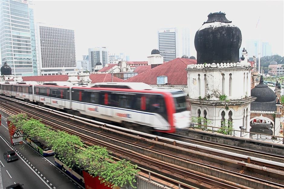 The view of this majestic building, the former Federated Malay States (FMS) Survey Department headquarters built in 1910, is disturbed by an LRT whizzing past it in Kuala Lumpur.
