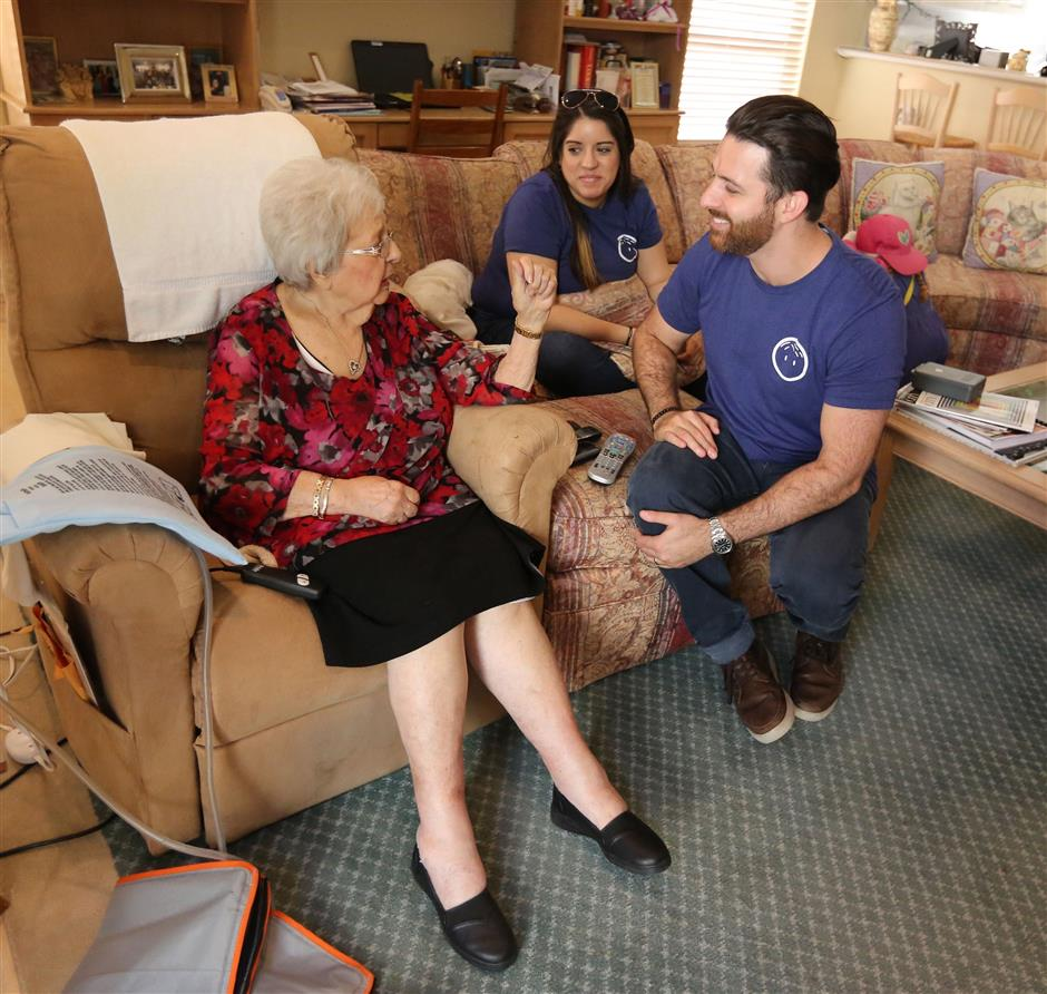 Olga DeMartino, 92, visits with Papa founder Andrew Parker and Papa employee, Valeria Sosa, 26, on Tuesday, Nov. 14, 2017, in her Coral Springs, Fla. home. (Emily Michot/Miami Herald/TNS)