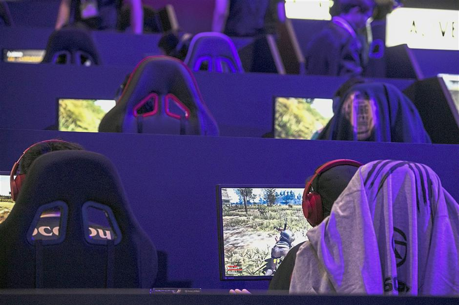 Participants playing in an e-sports competition in Chiba, Japan, in February. Hundreds of players faced off in the two-day competition for more than US300,000 (RM1.2mil) in prizes. – Bloomberg