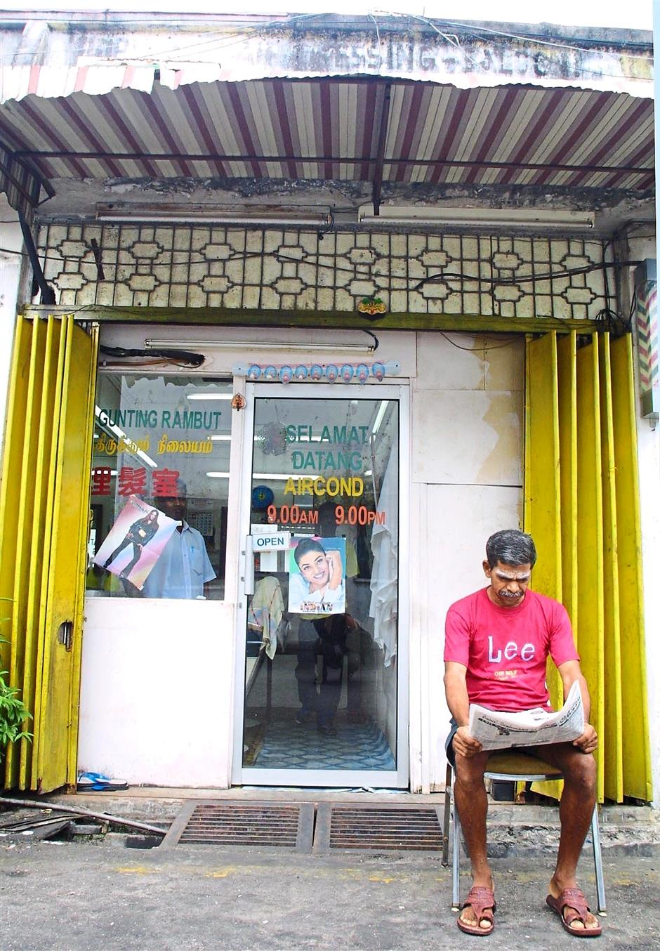 Support system: Small businesses like this barber shop in Malaysia can find support in business networks and associations.