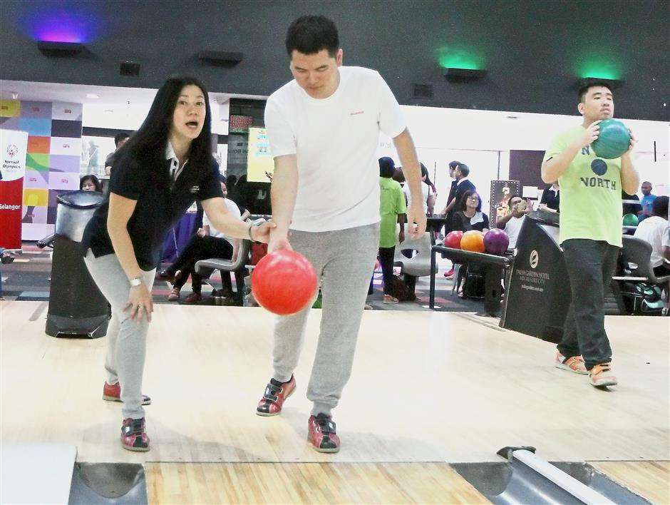 Unified bowling tournaments help to foster interaction between people with and without intellectual disabilities by being on the same team.