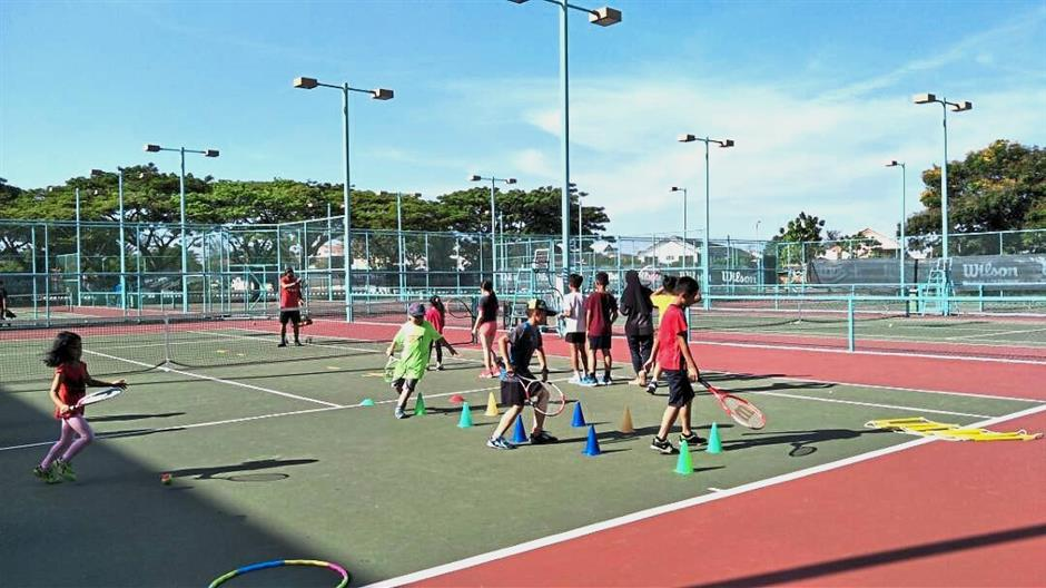 (Above and below) Miri Division Lawn Tennis Association (MDLTA) juniors learning the ropes during their weekly training sessions.